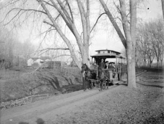 A horse drawn rail car carries passengers to Fort Logan - 1890-1900
