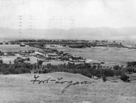 Panoramic view of buildings, roads, and trees at Fort Logan - 1910.
