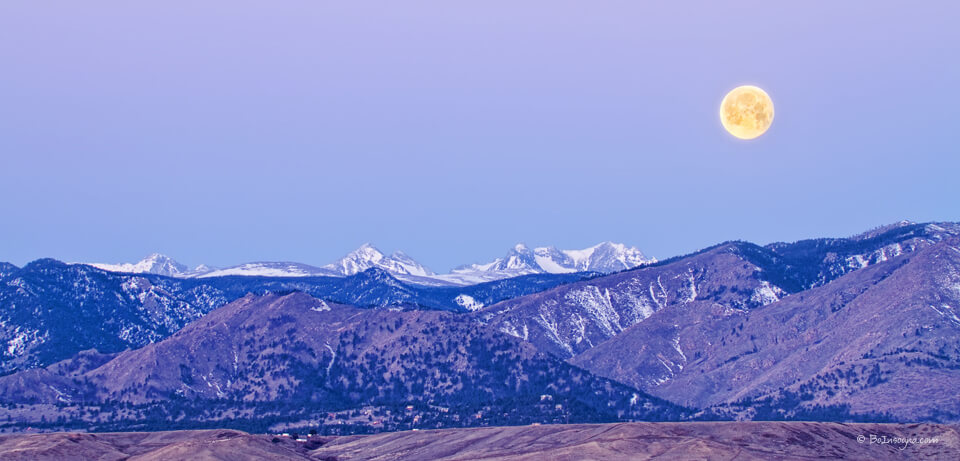 Full Moon Setting Over The Colorado Rocky Mountains