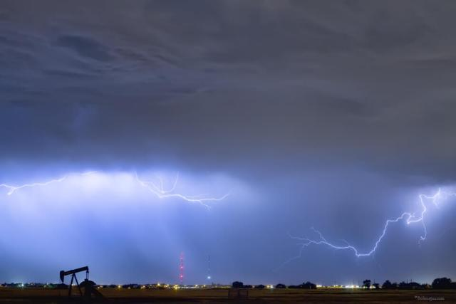 Lightning Strikes Above Oil Field Art Print
