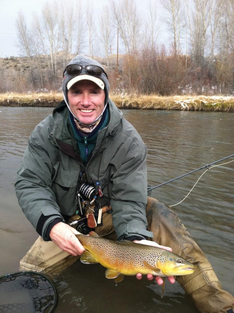 Reid Baker displays a wintertime brown trout.