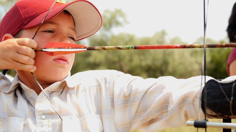A young archer takes aim with a bow at a CPW Field Day. Video capture by Jerry Neal/CPW.