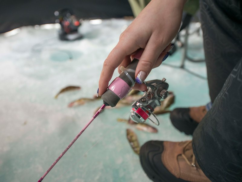 A small jigging spoon, a light rod, and a delicate touch were the right stuff for putting scores of small perch on the ice.