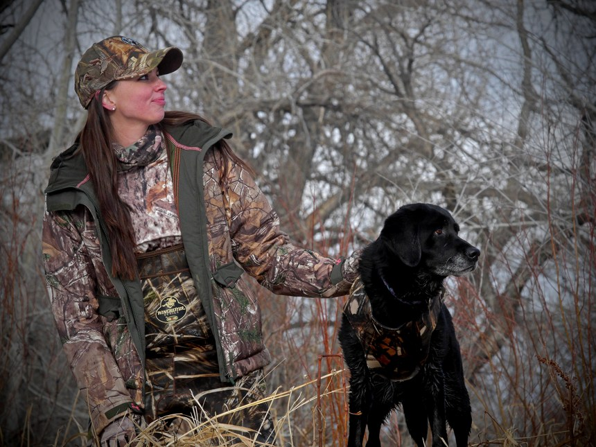 Hunter Cathy Brons and a black Lab.