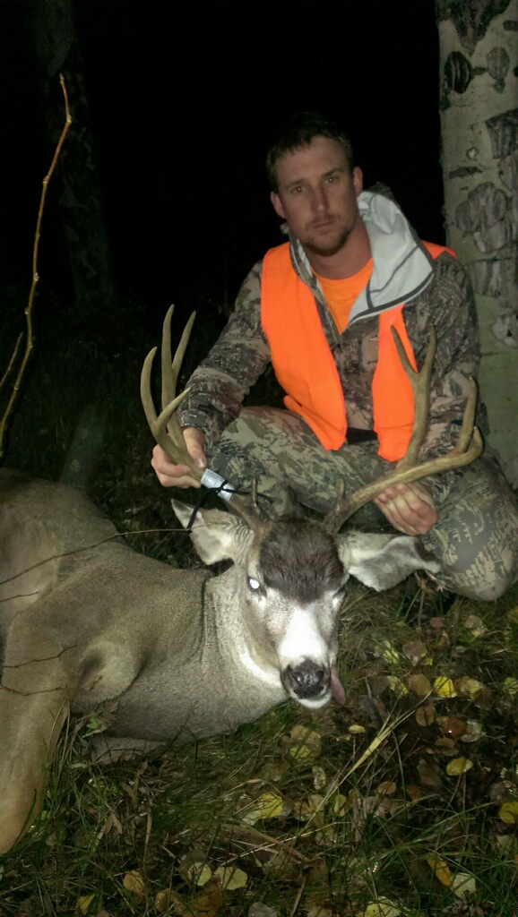 Blake Collins with his mule deer buck. Photo by Alex Collins.