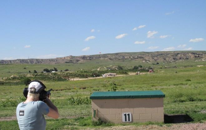 Melinda Miller shoots at a clay bird as it breaks the horizon. Photo by David Lien.