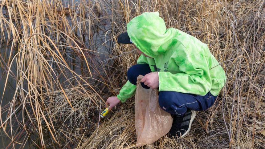 Theo picking up trash.