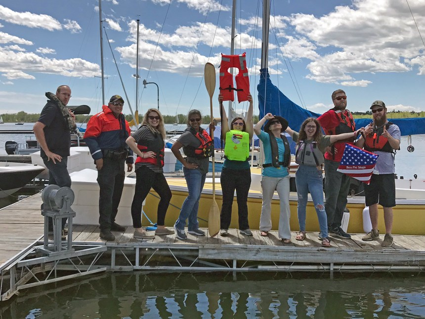 "CPW Staff and Volunteer celebrate ""Take Your Life Jacket to Work Day."""