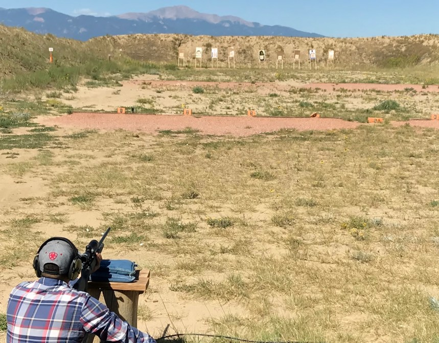Travis practices at the 100-yard shooting range.