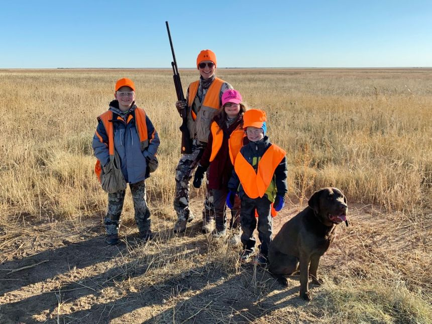 Ready to hunt birds are, left to right, Tyler Anderson (age 11), Lisa Anderson, Adeline Anderson (age 9), and Ryan Anderson (age 6). The family is attending the free 2019 Rookie Sportsperson Program offered by Colorado Parks and Wildlife's Southeast Region in Colorado Springs.