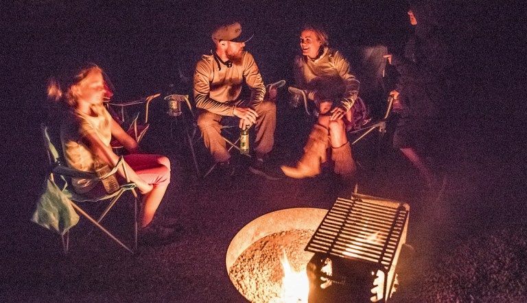 Family enjoying a campfire