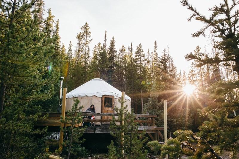 reading on yurt porch