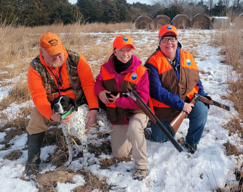 Darcy Mount, far right, poses with hunting partner Olivia Braun, center, guide Bubba and his hunting dog Mickey.