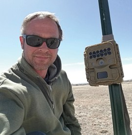 Ed Schmal, CPW conservation biologist with a wildlife camera.
