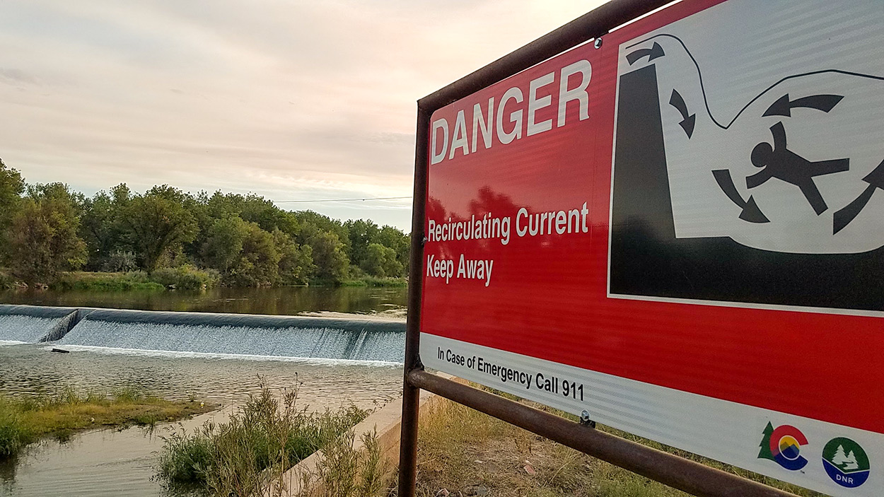 low head dam sign
