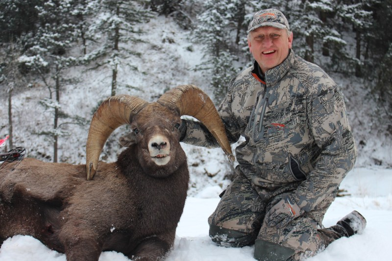 hunter with bighorn sheep
