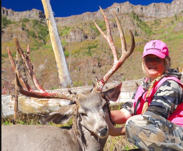 hunter with mule deer