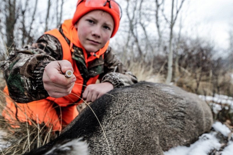 Youth Hunter with doe