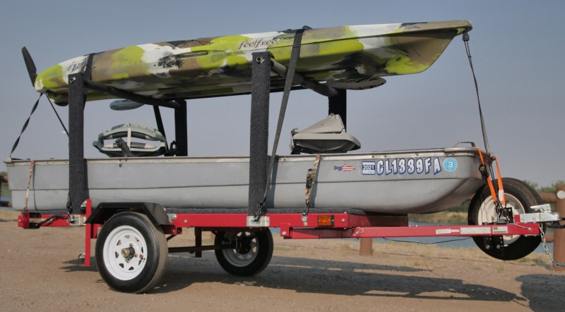 Custom trailer carrying two boats