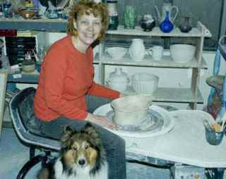 Wendy at her wheel with her studio mate