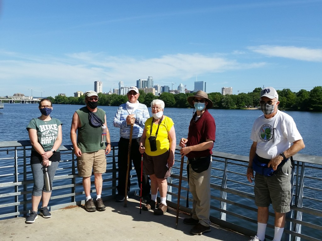 Lady Bird Lake YRE, group of walkers in front of Austin skyline