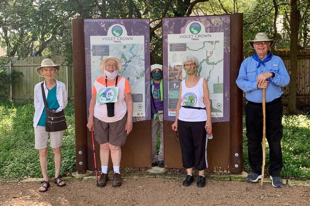 CRW members by Violet Crown Trail signs