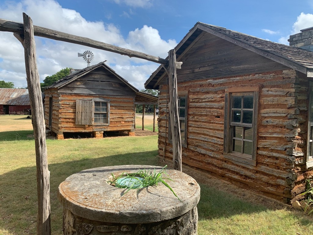 Old Settlers Park, historic cabins and well