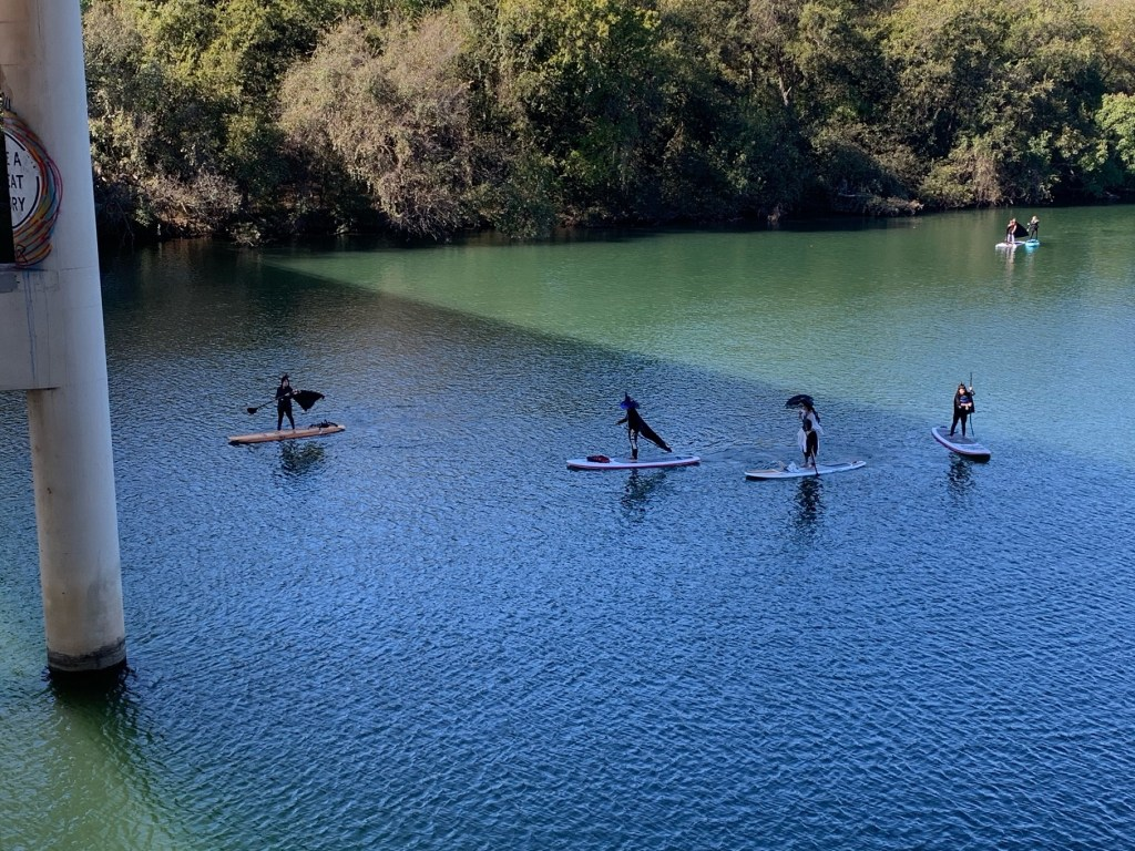 Halloween paddleboarders on Lady Bird Lake.
