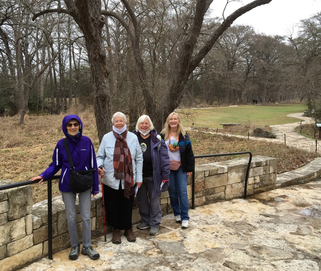 group of walkers at Blue Hole in Wimberley