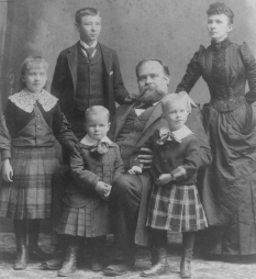 The Hogg Family: James stoic and centered, with Ima, Will, Tom, Will, and Sarah Hogg
