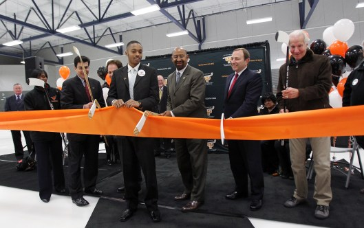 Philadelphia Mayor Michael Nutter (second right), NHL Commissioner Gary Bettman and Flyers Chairman Ed Snider  cut ribbon on renovated Laura Sims rink. (Photo: ESHYF)