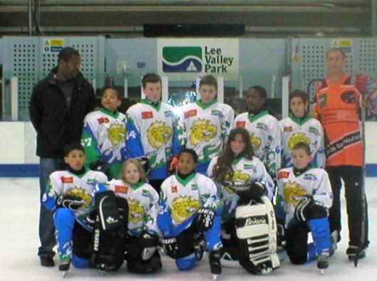 Eddie Joseph, left, hopes his players grow up to teach their kids ice hockey.