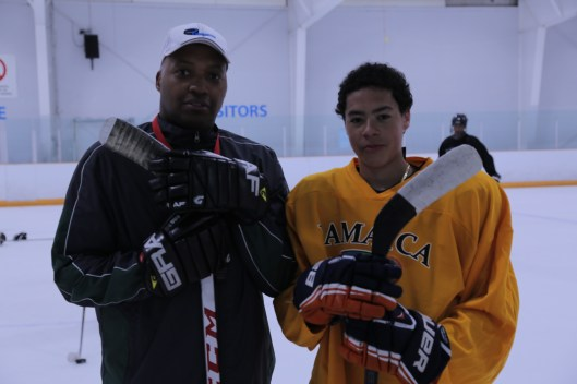 Skillz Hockey's Cyril Bollers (left) provided his coaching expertise to the Jamaican hockey effort.