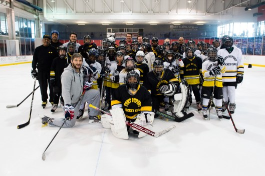 Thirty-five players from the Fort Dupont Ice Hockey Club hang with Capitals captain Alex Ovechkin (Photo/Patrick McDermott)