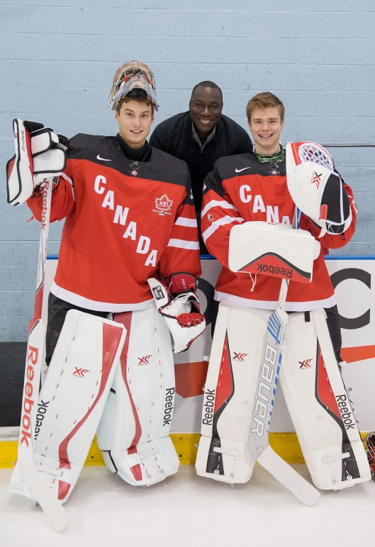 Goalies Zach Fucale (left) and Eric Comrie (right) with goalie coach Fred  Brathwaite at 2015 IIHF World Junior Championship (Photo/ Matthew Murnaghan/Hockey Canada)