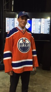 Defenseman Caleb Jones sports Edmonton's new retro jersey. He hopes to join big brother Seth Jones in the NHL.