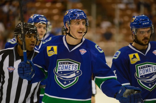 Alphonso, left, worked the AHL's 2015 Calder Cup Final between the Utica Comets and Manchester Monarchs (Photo/Courtesy Lindsay A. Mogle/Utica Comets)