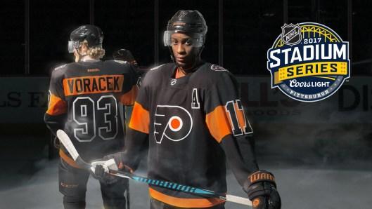 Philadelphia Flyers forwards Wayne Simmonds and Jakub Voracek model the team's Coors Light Stadium Series jersey.