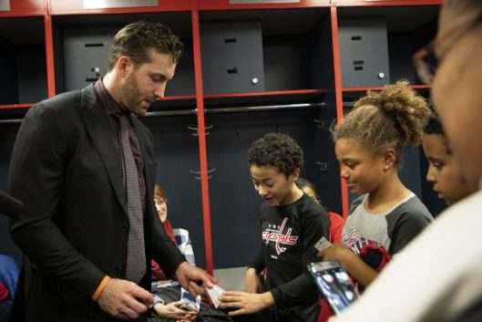 Washington Capitals defenseman Brooks Orpik signs autographs for some of  the kids who attended the Black Girls Hockey Club meetup at the Capitals-Buffalo  ... e97ac02ac612