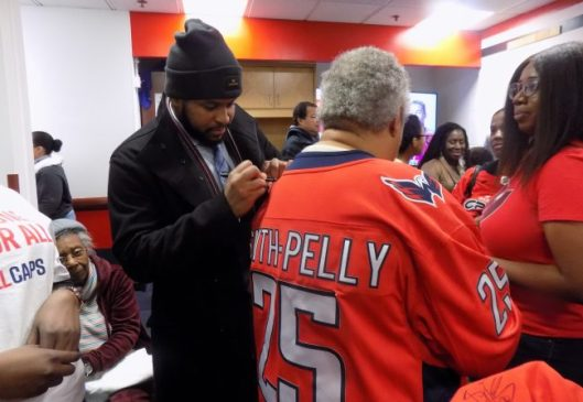 8779d8767b3 Washington Capitals forward Devante Smith-Pelly signs Black Girl Hockey  Club member Corinne McIntosh-Douglas  jersey (Photo Oyin Adedoyin Morgan  State ...