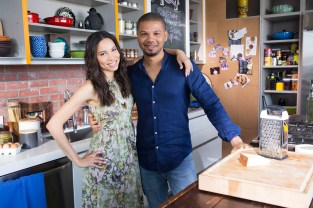 Jurnee and Jake pose for a photo before cooking, as seen on Cooking Channel's What's Cooking With The Smollets, Season 1.