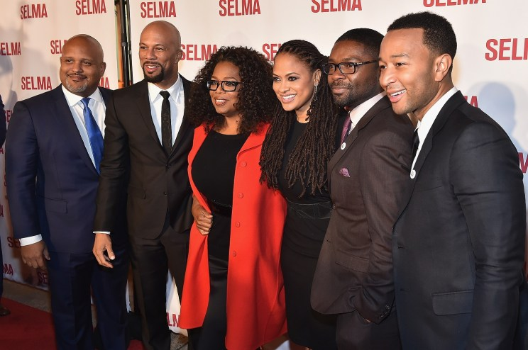 """SELMA, AL - JANUARY 18: EDITORIAL USE ONLY Executive Producer Paul Garnes, Common, Oprah Winfrey, Director Ava DuVernay, David Oyelowo, and John Legend attend a special screening of """"Selma,"""" presented by Paramount Pictures on January 18, 2015 in Selma, Alabama. (Photo by Paras Griffin/Getty Images for Paramount Pictures) *** Local Caption *** Common; Oprah Winfrey; Ava DuVernay; David Oyelowo; John Legend; Paul Garnes"""