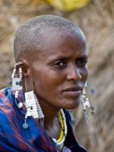 Maasai woman in traditional clothing and jewellery in the Serengeti National Park, Tanzania. (William Warby/Creative Commons**)