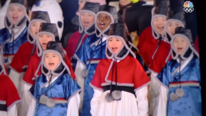Children from different races sing the South Korean national anthem in traditional clothes.
