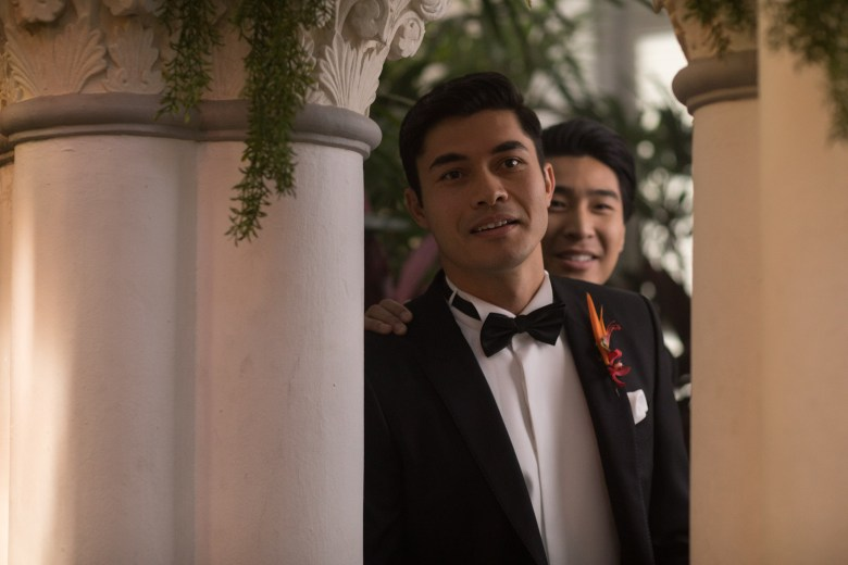 """Photo Credit: Sanja Bucko Caption: (L-R) HENRY GOLDING as Nick and CHRIS PANG as Colin in Warner Bros. Pictures' and SK Global Entertainment's and Starlight Culture's contemporary romantic comedy """"CRAZY RICH ASIANS,"""" a Warner Bros. Pictures release."""