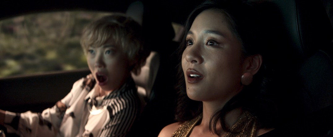 """CRA-FPTB-0062rv2 Film Name: CRAZY RICH ASIANS Copyright: © 2018 WARNER BROS. ENTERTAINMENT INC. AND KIMMEL DISTRIBUTION, LLC Photo Credit: Sanja Bucko Caption: (L-R) AWKWAFINA as Peik Lin and CONSTANCE WU as Rachel in Warner Bros. Pictures' and SK Global Entertainment's and Starlight Culture's contemporary romantic comedy """"CRAZY RICH ASIANS,"""" a Warner Bros. Pictures release."""