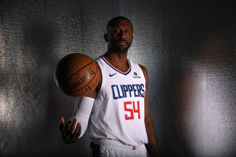 Patrick Patterson in his LA Clippers jersey tosses a basketball