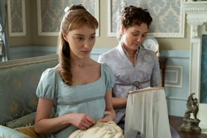 Daphne (Phoebe Dynevor) looking suspicious while she does needlework with her mother, Lady Violet Bridgerton (Ruth Gemmell). (Photo credit: Liam Daniel/Netflix)