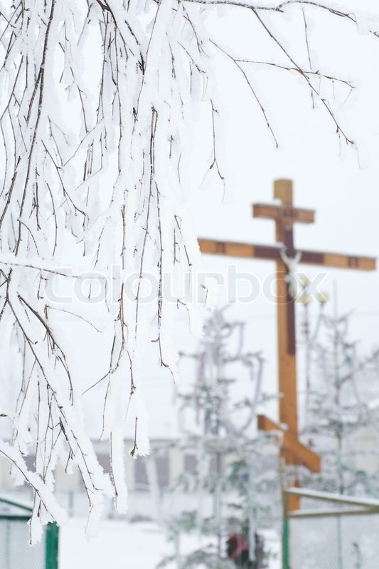 Rime Covered Branch Of Tree And Wooden Cross On A Back
