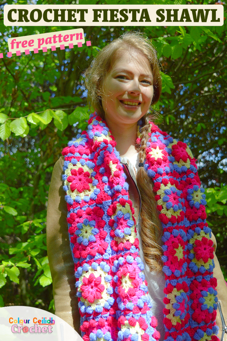 This simple and easy beginner rectangle crochet shawl only uses two stitches for texture and bold color combinations using Stylecraft Special DK yarn including Bright Pink and Fiesta to create a boho crochet shawl. Embrace your inner bohemian style chic with these puff stitch granny squares. Wear it like a warm scarf when you fold it in half or wrap it around your shoulders. Layer it over blue jeans and neutral shades. Free pattern. #crochetshawl #freecrochetpattern #stylecraftyarns